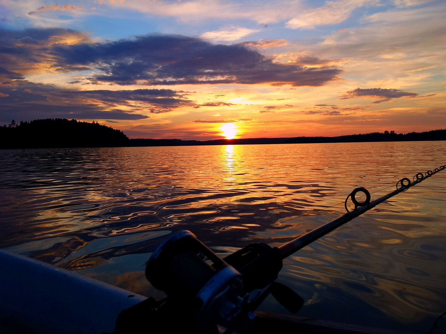 Fishing at sunset on the lake in Western Finland